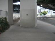 Column in sidewalk